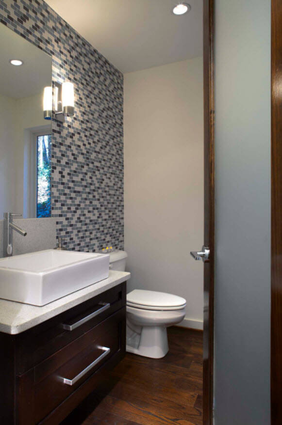 Small bathroom with small tiles gray shades