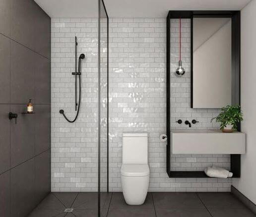 White rectangular ceramics tiles in small bathroom