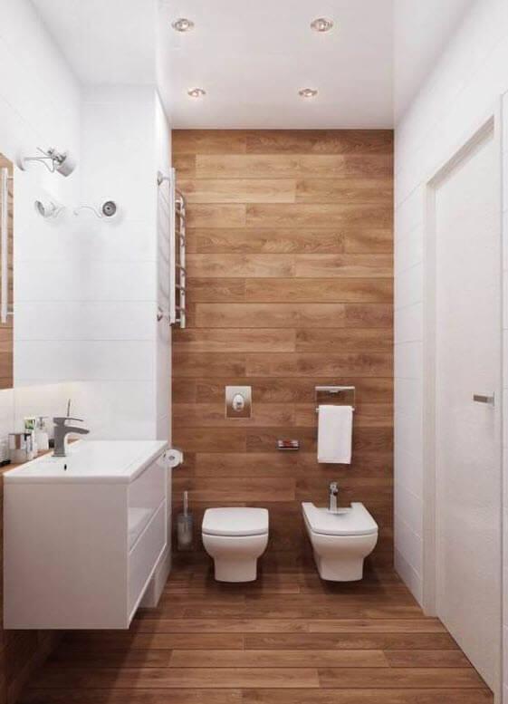 White tiles and small wood bathroom decor