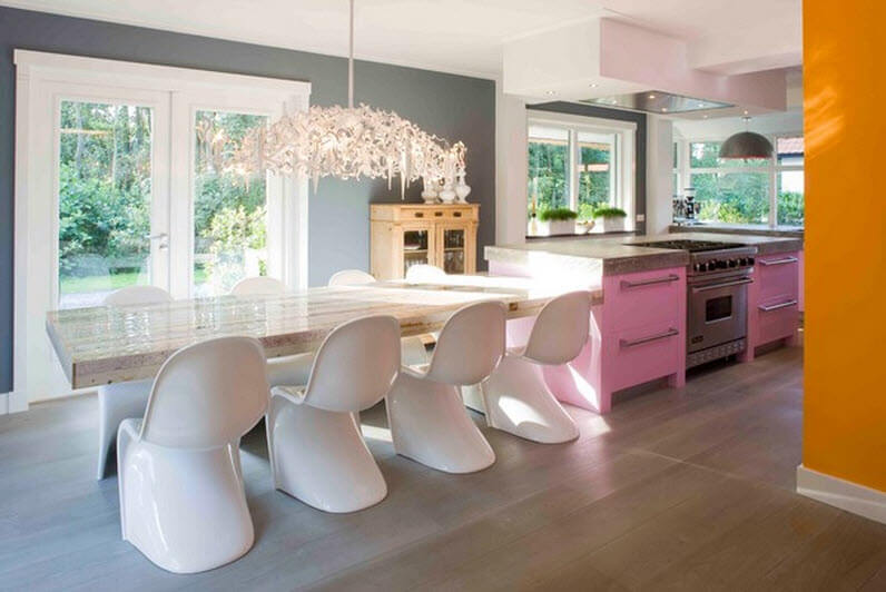 Kitchen design with dining room art