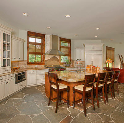 Kitchen design with stone floor and white furniture