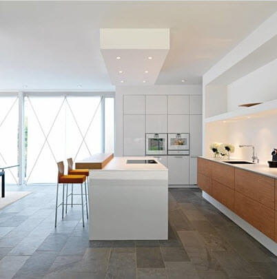 Kitchen with ceiling spot lighting over the countertop