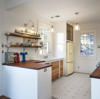 Kitchen with white decorated floors