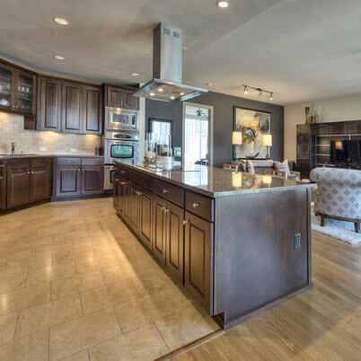 Large kitchen with dark wooden furniture and living room combo