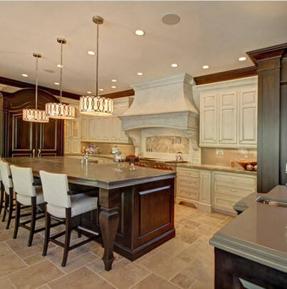 Marble floors in kitchen with cedar cabinets