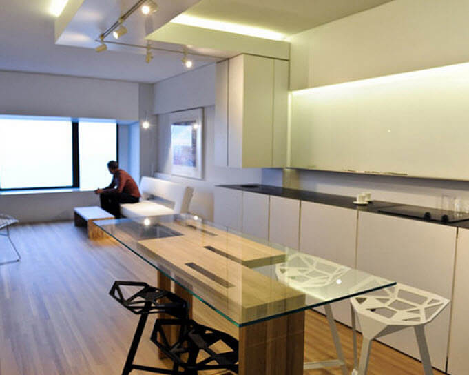 Modern kitchen design with glass table