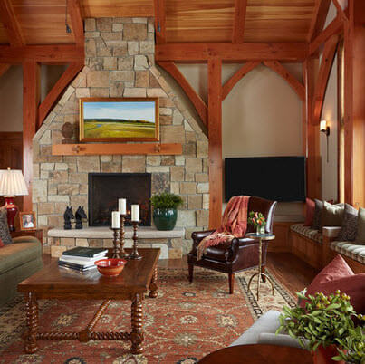 Rustic living room with ceiling beams and stone fireplace