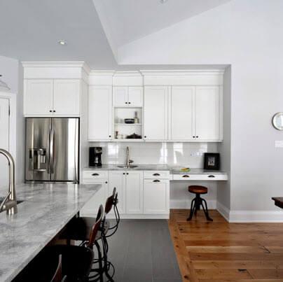 White kitchen design with chromed fridge