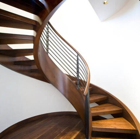 wooden spiral staircase with metal railing design