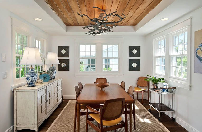 coastal style dining room with shiplap ceiling