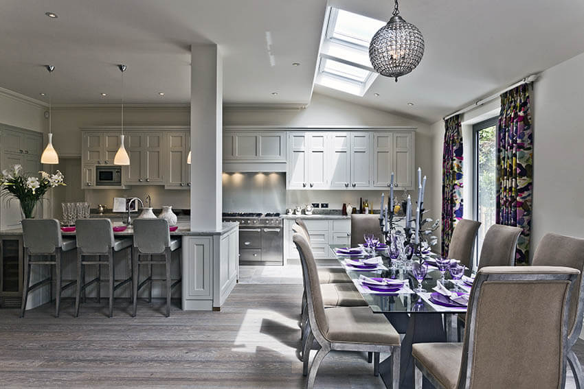 contemporary transitional dining room with globe pendant light