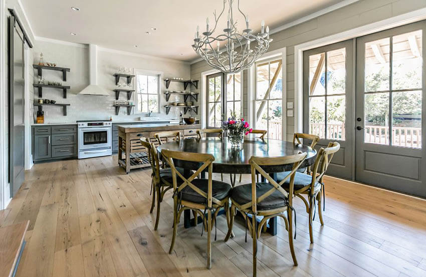 dining area with painted shiplap walls and wood flooring