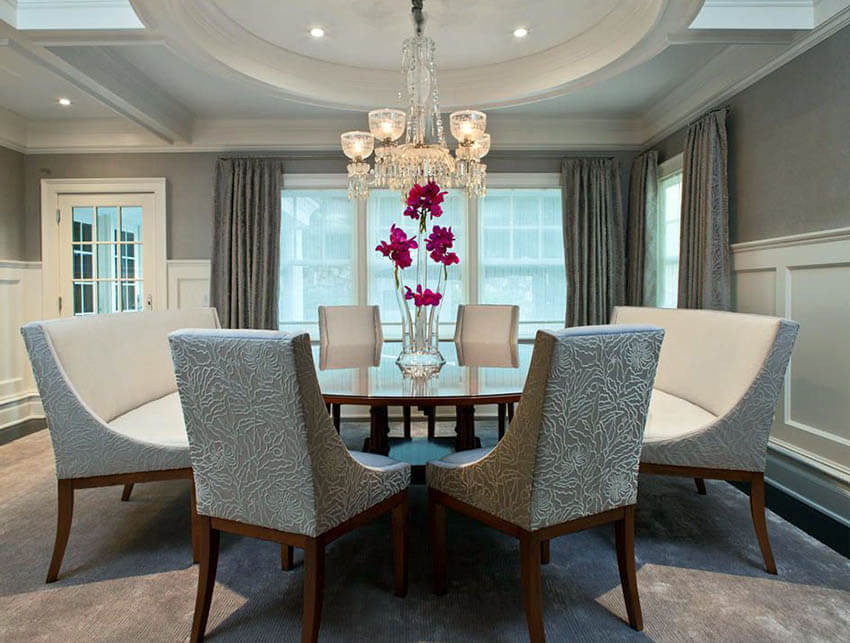 gray dining room with chandelier and recessed lights