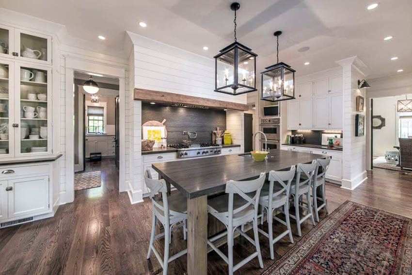 luxury farmhouse kitchen with shiplap walls and white cabinets