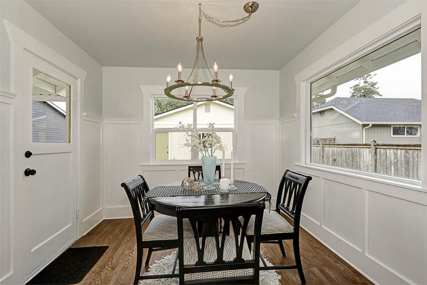small traditional dining room with brass hoop chandelier with candle lights