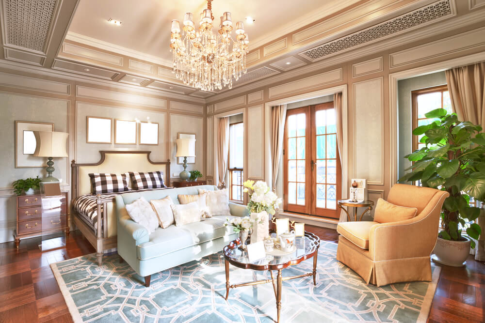 How to decorate your master bedroom wall designs ideas and inspiration. Golden crystal chandelier with high ceiling wallpaper and design. Massive dark shinny hardwood floor partially covered by a beautiful blue carpet. Matches the two seat loveseat and the glass coffee table.