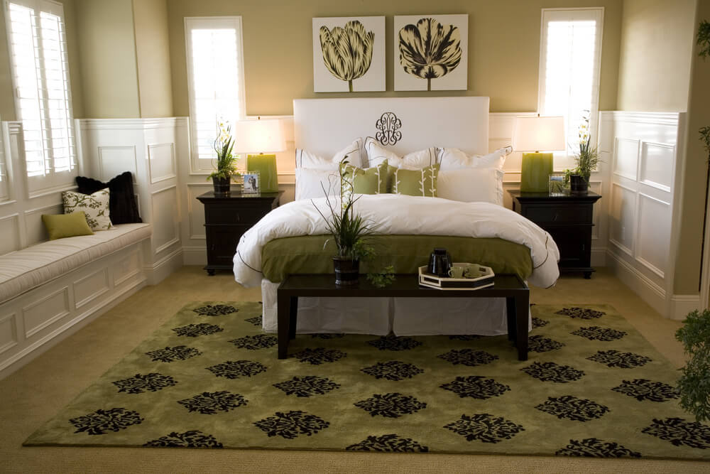 Luxury master bedrooms celebrity bedroom pictures - White and light green color combination. Light green pillows, light green carpet and bed cover in contrast with white and beige walls and bed. Plants are a must in this decor.