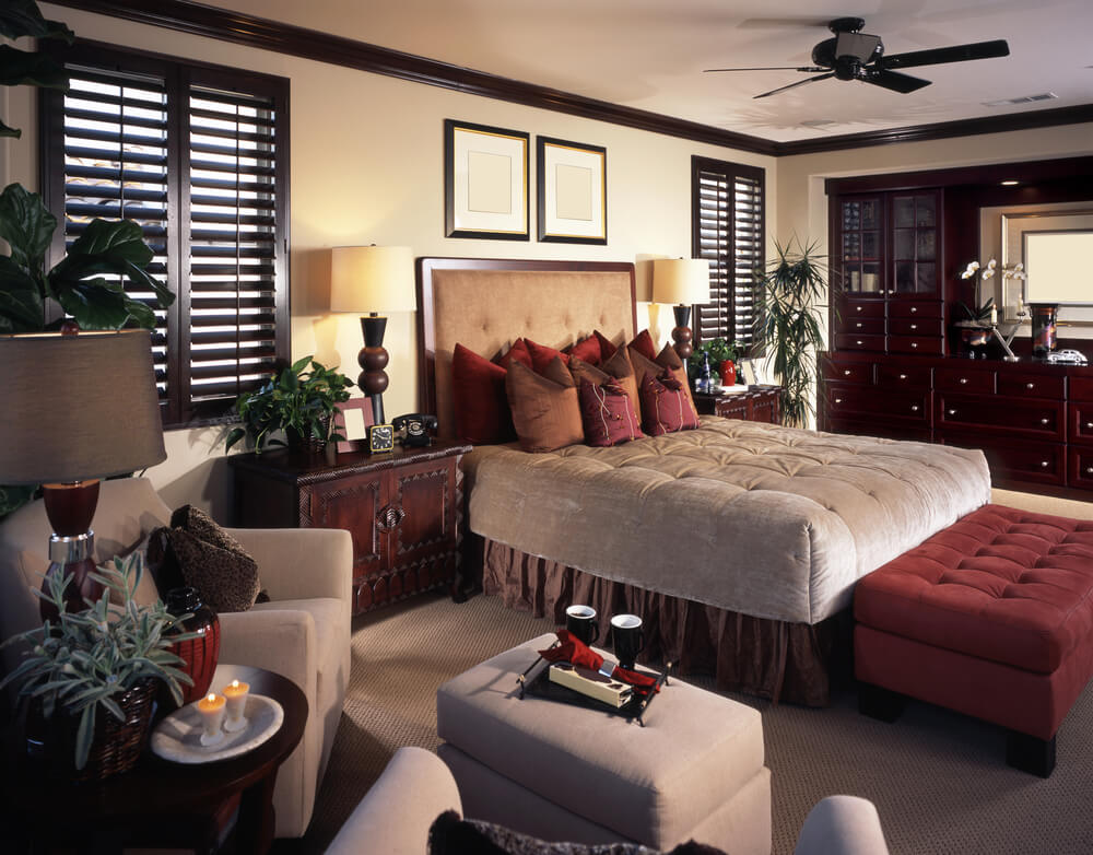 Master bedroom designs with wardrobe malfunctioning large room with plenty of shelves for additional storage and seats for enjoying coffee or reading. Very good decor ideas added by the red pillows and the red seat at the foot of the bed.