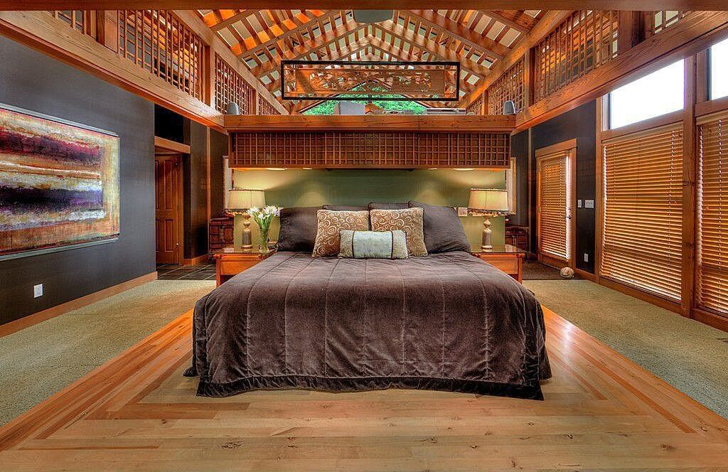 Master bedroom paint ideas with accent walls with wallpaper over the black wall. On the other side, there are large wooden windows sharers that don't let the heat and the direct sunlight come in. Also there is the attic integrated in the room. with additional wood finish and windows.