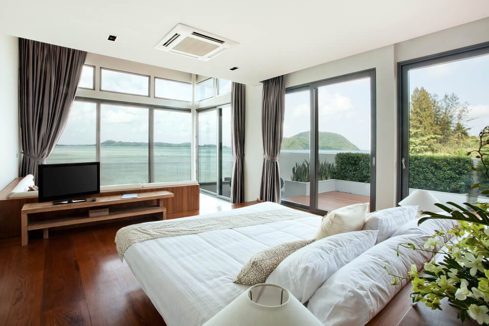 Small master bedroom decorating ideas bedroom designs - sliding glass doors to large patio overlooking the million dollar ocean view. The minimal design consists in a TV, well shaped bed and a L-shaped white sofa with a splendid view.