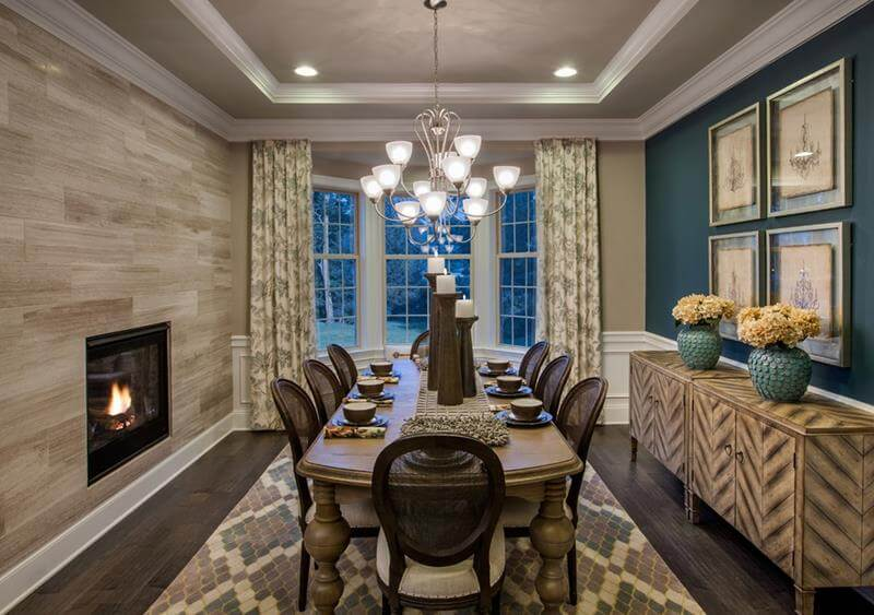 Dining Room Ideas and Designs with a modern dining grey wood table, dark wall paining and on the other side slender beige stone tiles in contrast with the beige patterned tiles flooring.