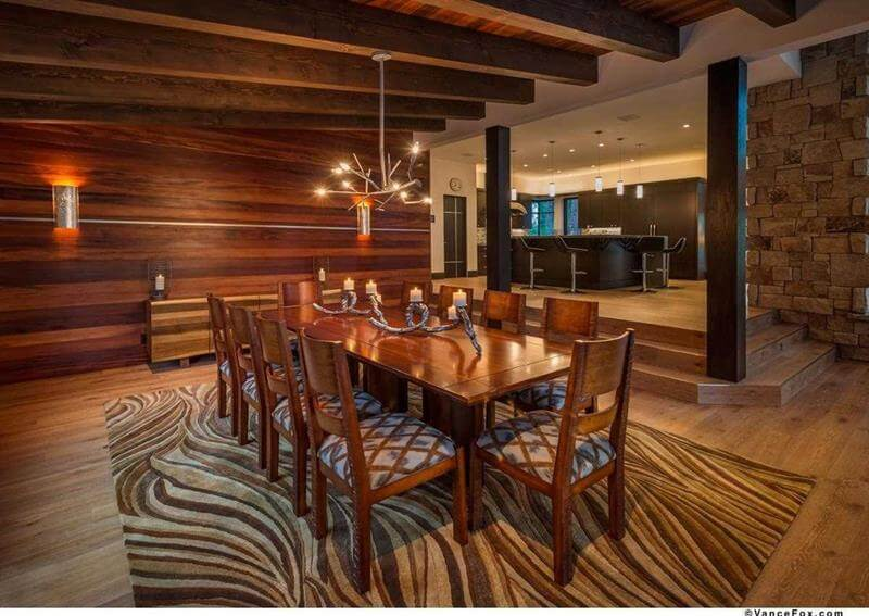 All-Wood Dining Room Design with a modern looking wooden dining table, wooden dining seats, and a superb patterned wooden hardwood flooring. Also the ceiling is made of wood with wooden beams.