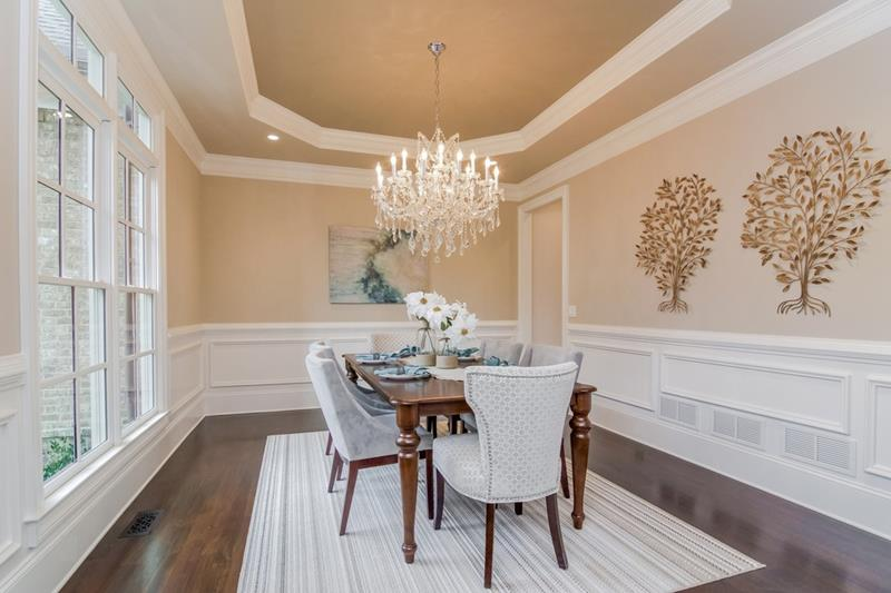 Dining Room with Beautiful Wall Colors Designs with peach color design walls with peach color ornaments and peach color ceiling, that blends with the white furniture and white rug.