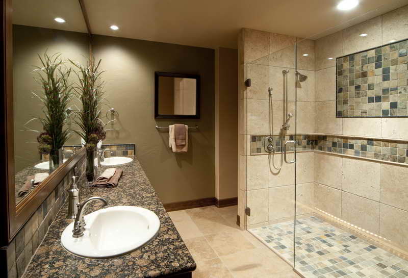 Bathroom color scheme ideas - This particular looking bathroom has earth tone scheme with pants and dark and light green wall tiles and a counter top made out of beautifully polished green granite.
