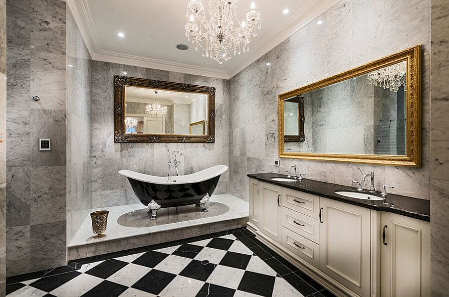 Bathrooms chandeliers that are added to really impress the viewer. The granite made walls with gray tiles, two large mirrors one with a golden bronze finish, the other one with a a wooden finish. Also a black bathtub with gray clawfoot.