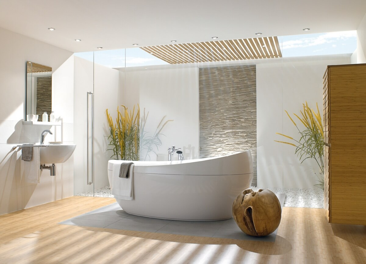 Bathrooms with fabulous bathtubs and also windows in the ceiling,that lets the natural light inside. A natural wooden color big drawer with plants.