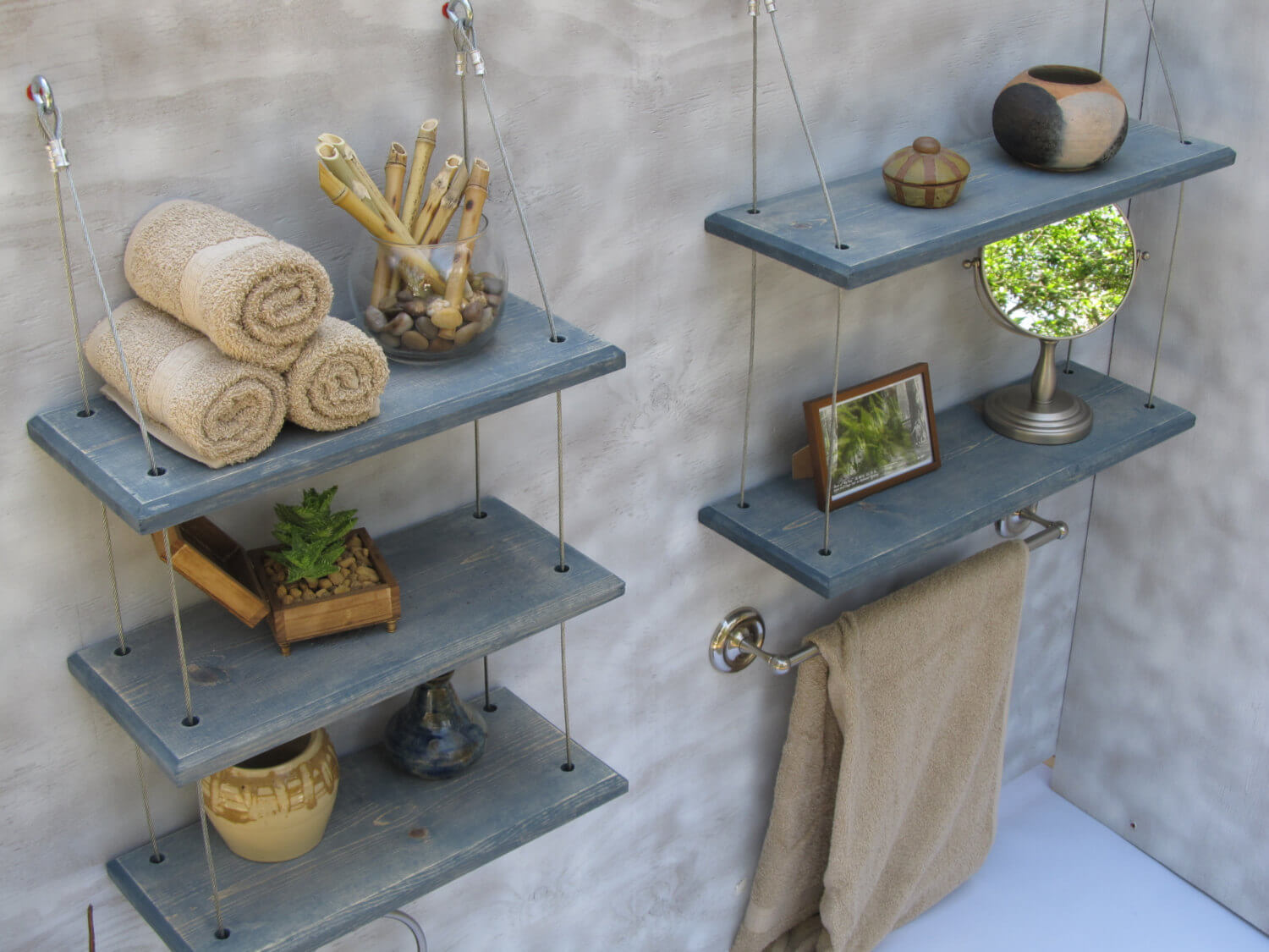 Bathrooms floating shelves with small and practical blue shelves without any hidden containers. The blue shelves are kept in place with sturdy ropes.