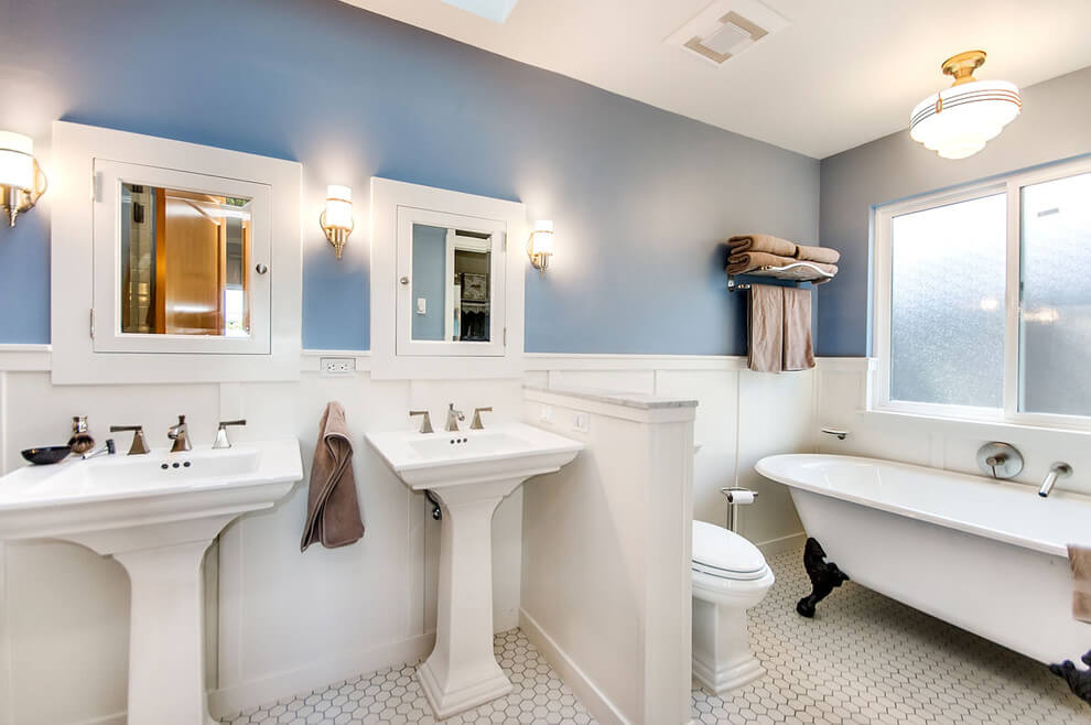 Bathrooms pedestal sinks ideas and designs. Two white pedestal sink ideas, each with it's own mirror that was a hidden cabinet. Also a small half size wall separates them form the toilet bowl and the bathtub.