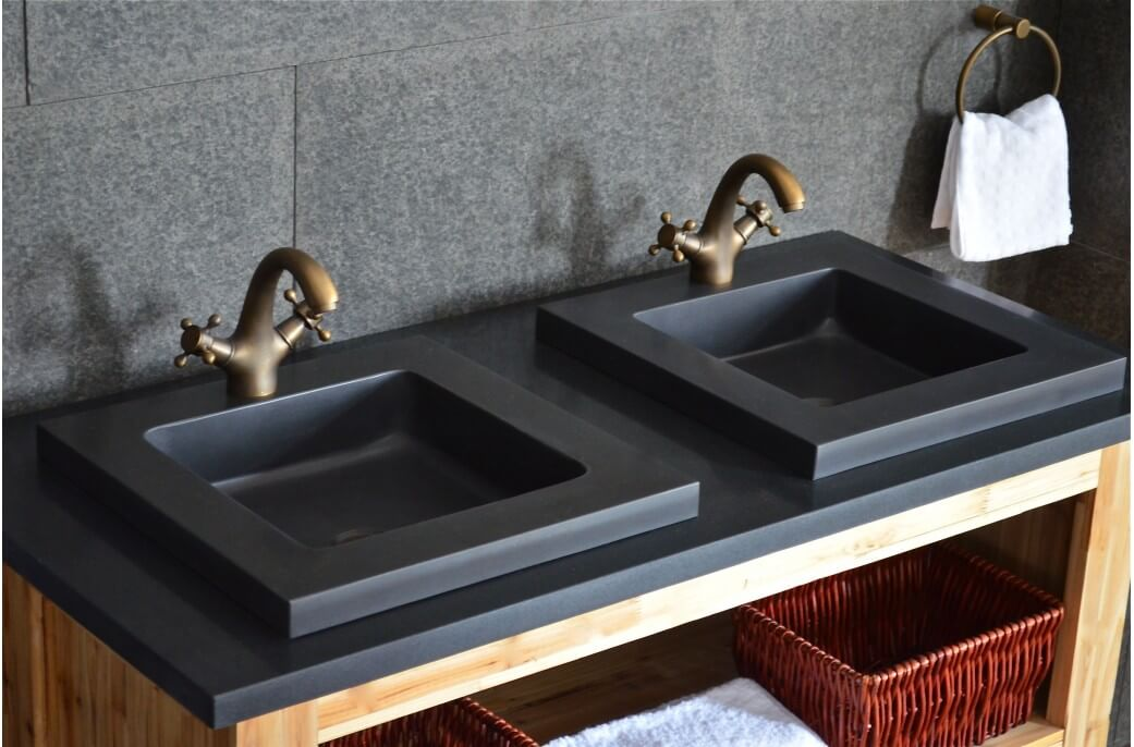 Bathrooms square sinks with a simple design, two metal finished blue sinks that have a lot of storage space underneath in baskets.