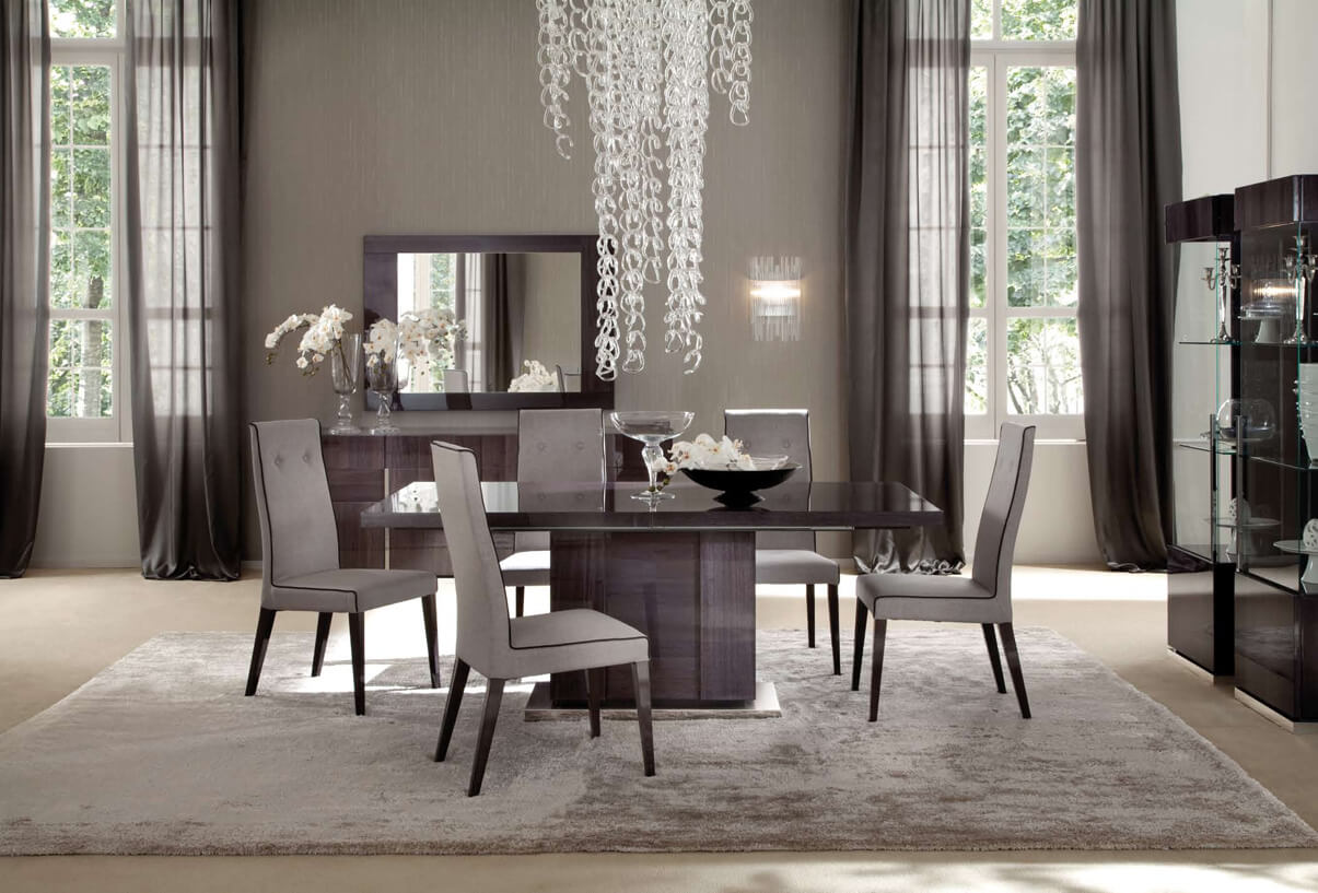 Contemporary dining rooms with grey chairs and a large and tall chandelier over the center room table . This beautiful but simple living room was large windows with grey drapes.
