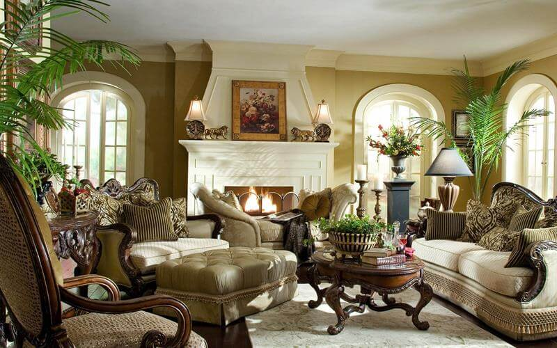 Elegant living rooms with natural green tone design with plants in every corner, white fireplace and carpet, dark wood furniture.