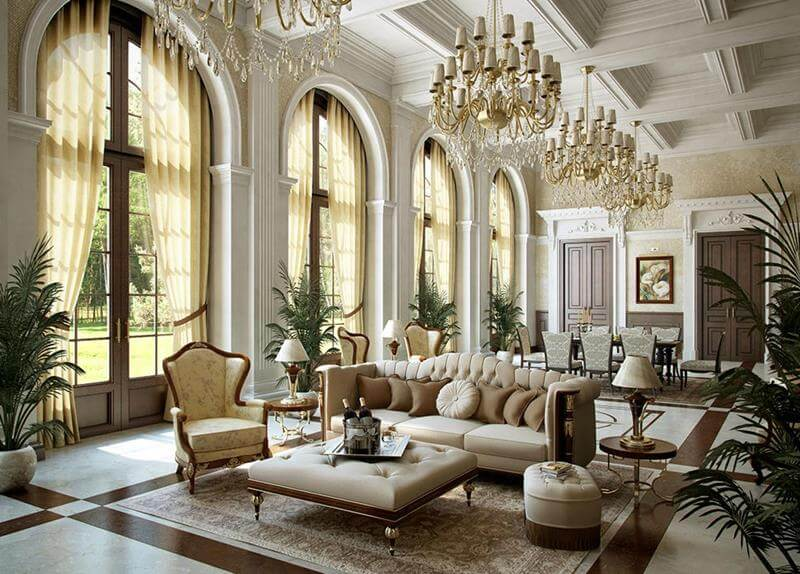 Grand living rooms suitable for a palace. This room also incorporates a dining area with eight seats. Four chandeliers hang above the luxurious living room. White and brown marble also large arches that have windows.