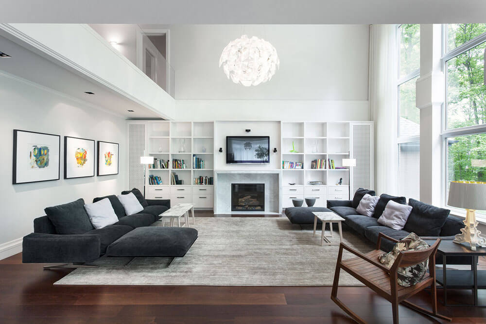Living room interior design with modern furniture and white walls, beige carpet and wall made of glass.