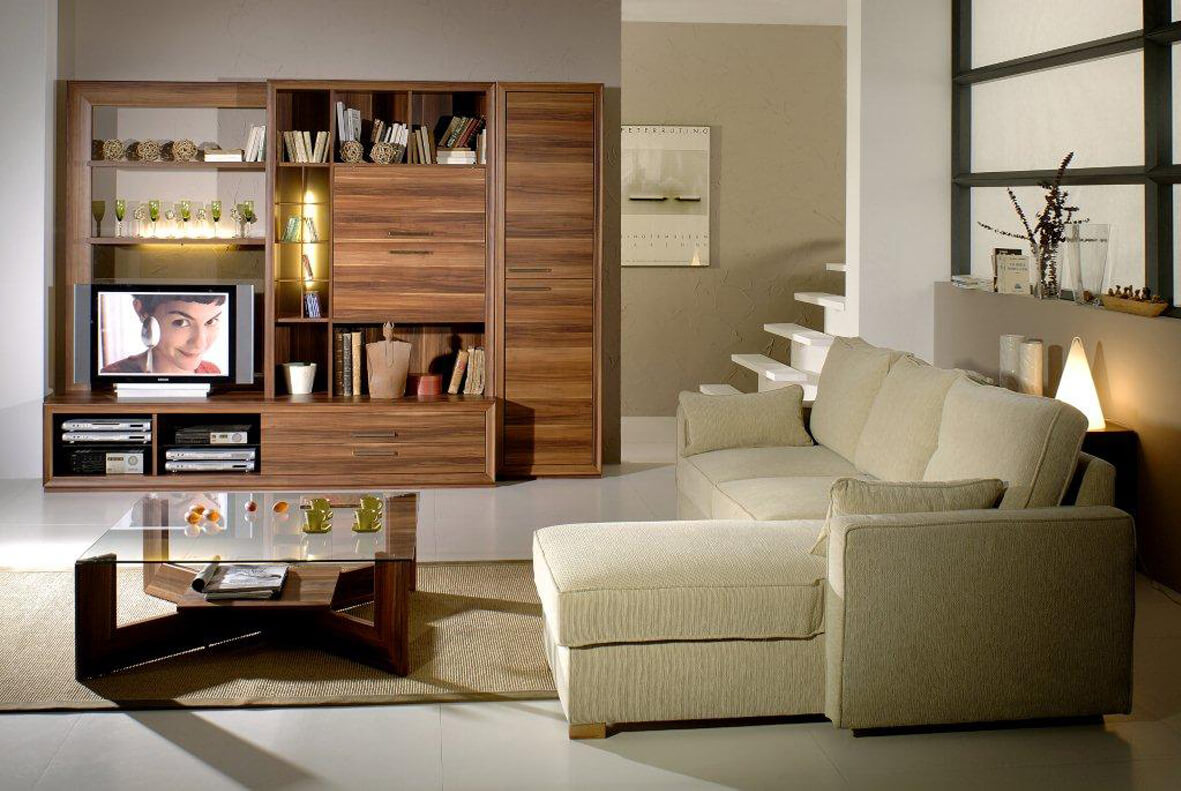 Living room storage ideas with wood insertions and wooden shelves and drawers. Large L shaped sofa with a stylish but small coffee table.