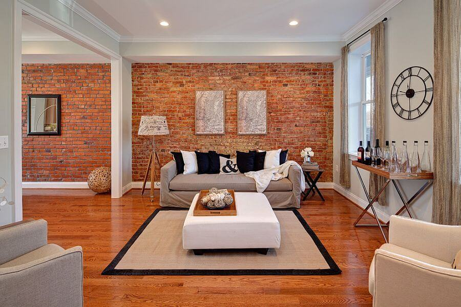 Living rooms accent walls - a superb orange brick wall with orange like wooden flooring in contrast white furniture sets and white ceiling.