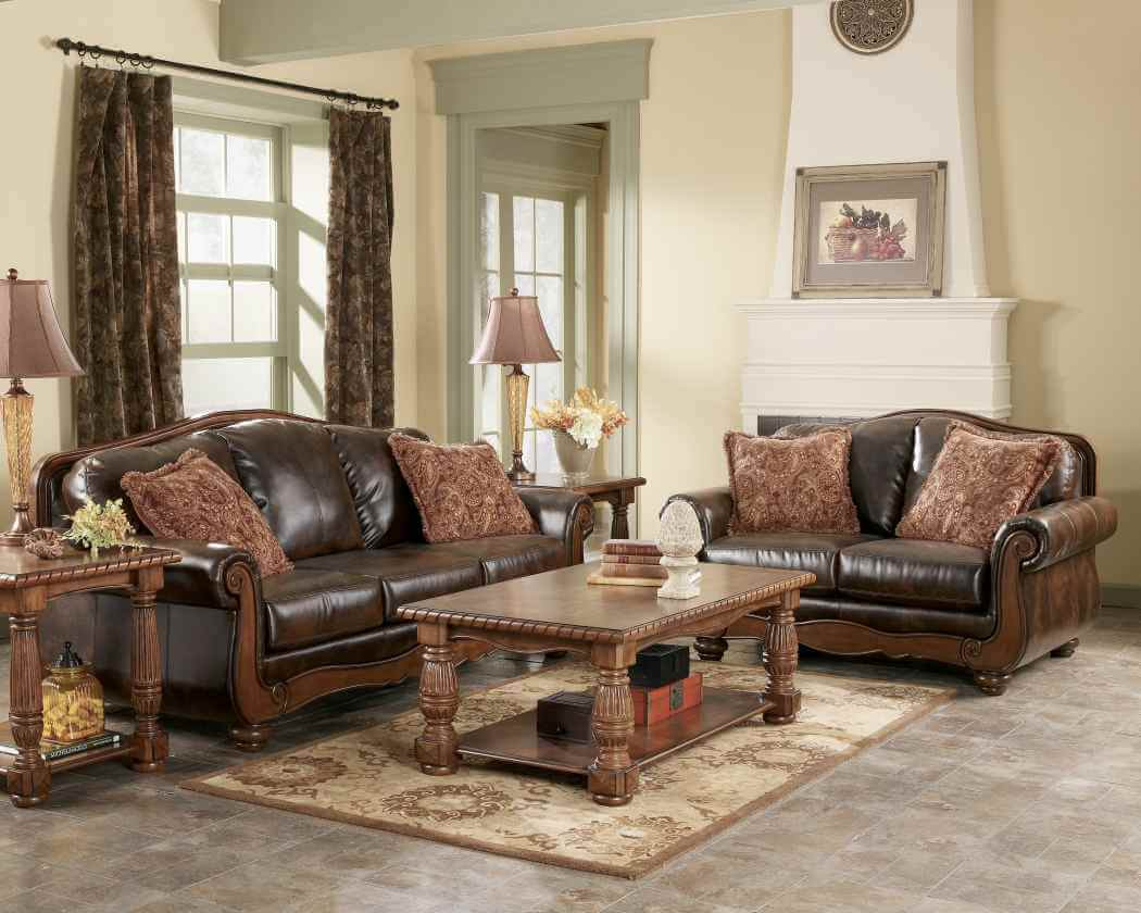 Living rooms antiques design and ideas. With a beautiful design, this rustic living area attracts the viewer with simplicity and with its heavy sculpted furniture.