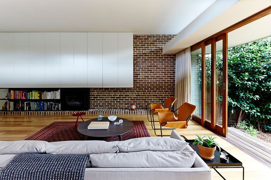 Living rooms brick walls - a great way to splash some color design on the house's interior walls. A retro look inspired form the 80'. Modern approach to a old fashioned set of furniture.