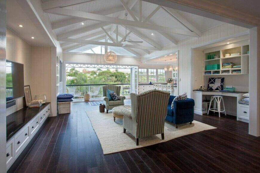 Living rooms exposed beams - great for visual effect. The white beams are the same the V shaped ceiling and in contrast with the dark mat finished wood flooring.