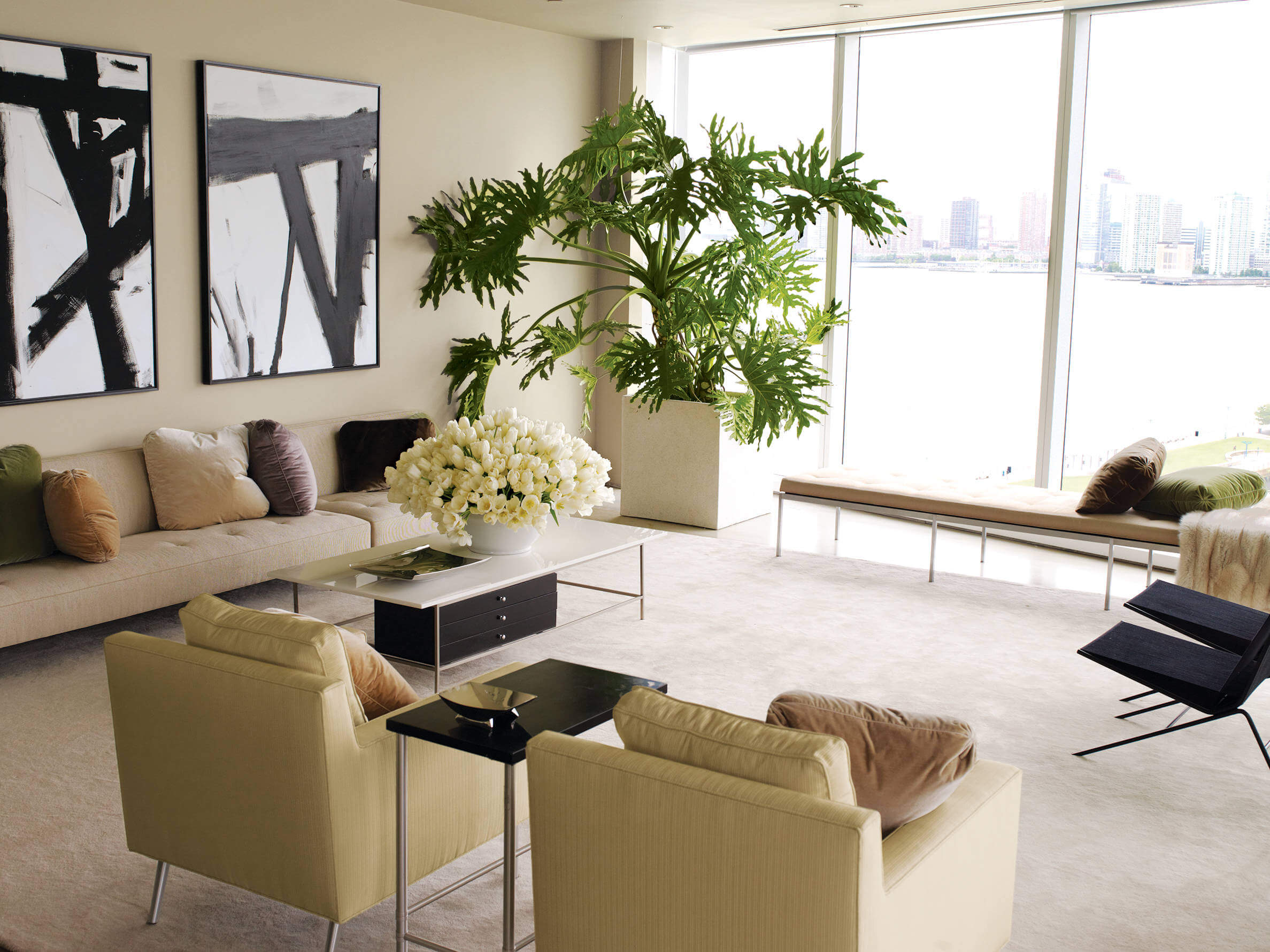 Living rooms houseplants that adds a fresh new look to your house. Plenty of Sun shine that enters the room trough that large glass windows.