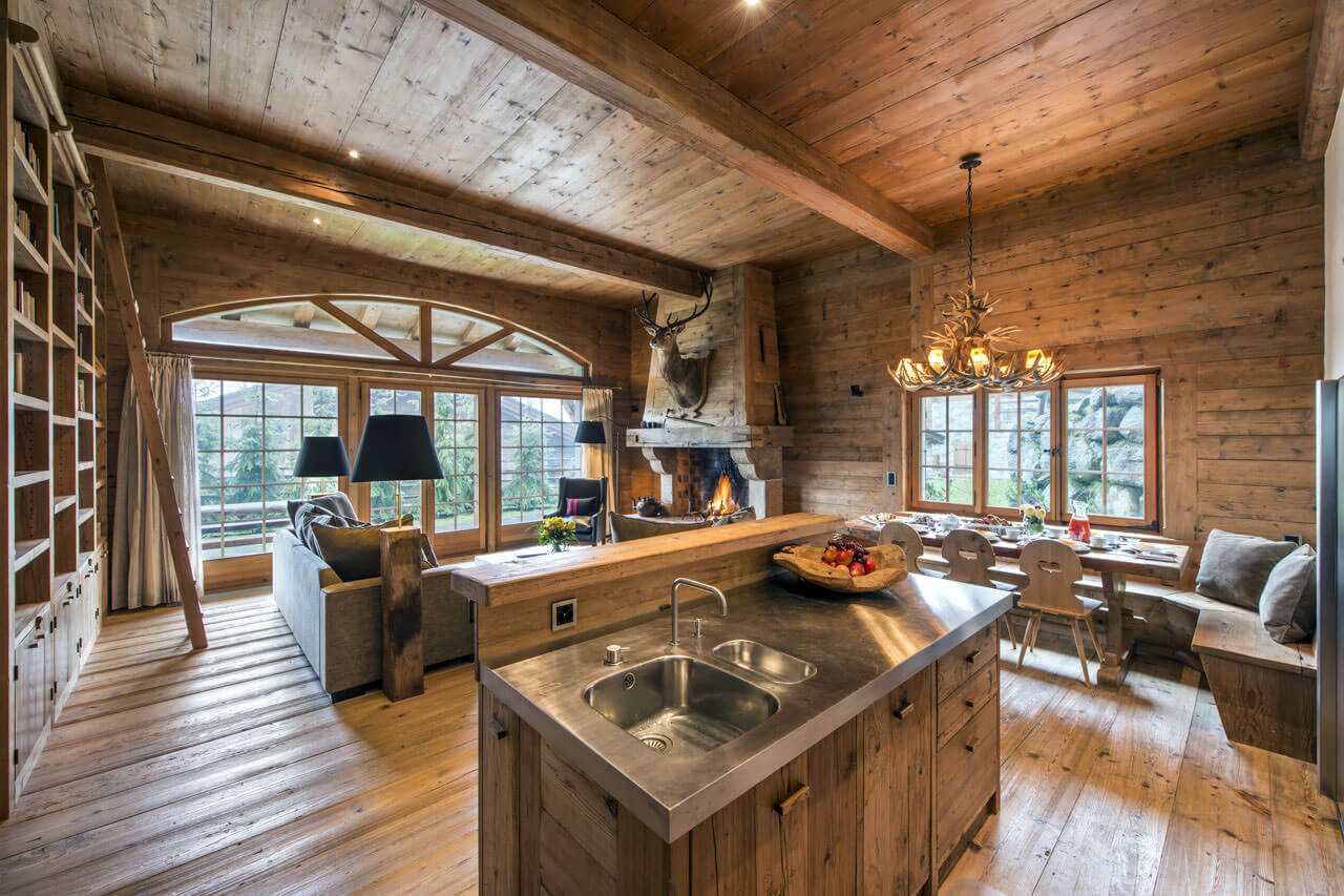 Living rooms kitchen openings - This concept best suits a mountain cottage where everything is made out of wood. A great design that also incorporates a dining area.