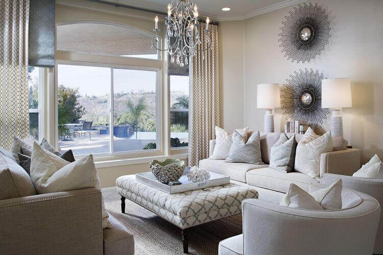 Living rooms with ottoman coffee table design. This room as great view overlooking the deck. Two white sofas and in the middle a small rectangular coffee table.