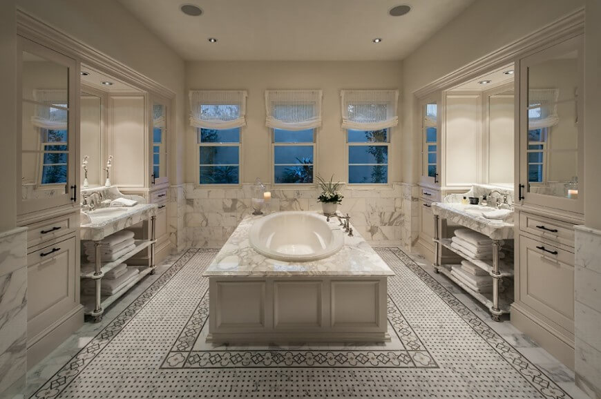 Master bathrooms with centered soaking tubs- Beautifully designed white marble with black small pieces of marble bathroom. Double sided sinks with a central oval master bathtub.