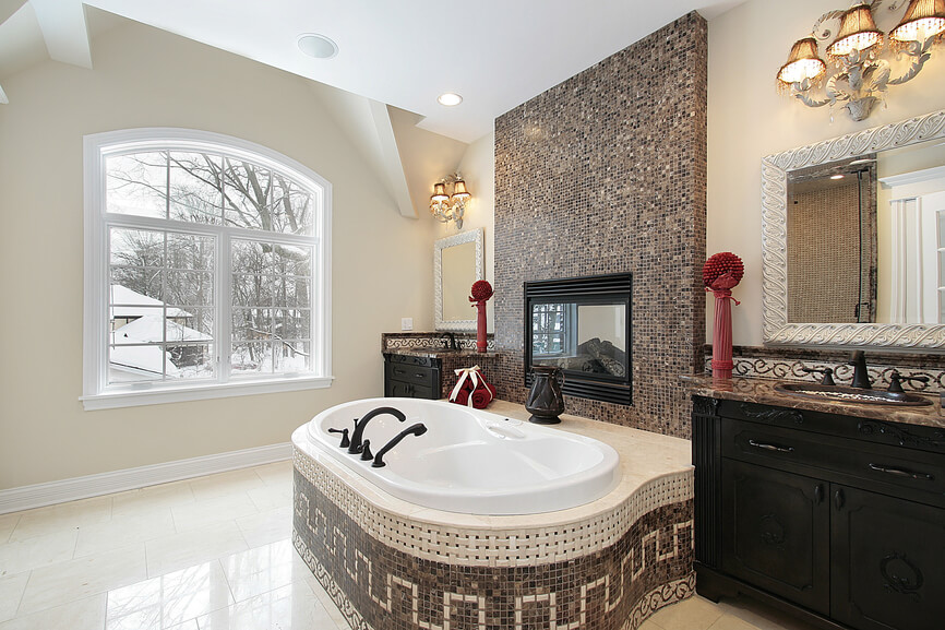 Master Bath in New Construction Home with Marble Tile Tub