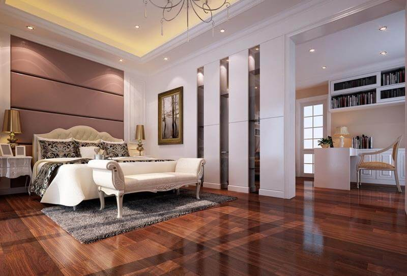 Splendid master bedrooms with hardwood floors with a polished design that reflects the light. A large queen size bed with a white loveseat near it.