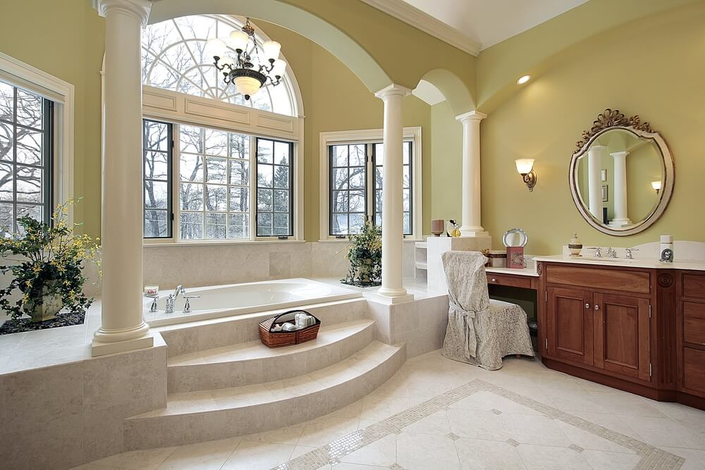 New home custom luxury bathroom designs with one big arch and tow small arches, that separates the bathtub area form the rest of the bathroom.