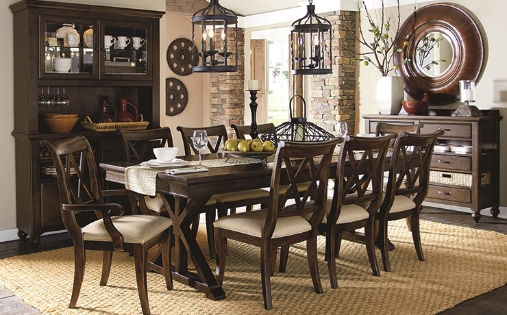 There are many types of dining room chairs, but in this unique European style kitchen the made of dark brown hardwood with beige fabric that are in contrast with the white walls and dark furniture.